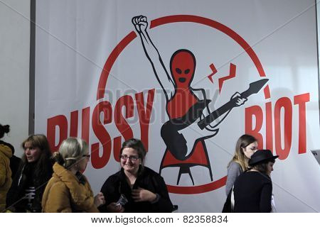 PRAGUE, CZECH REPUBLIC - FEBRUARY 7, 2013: People in front of the poster of Pussy Riot, a Russian feminist band, at the entrance to the exhibition Pussy Riot in Prague, Czech Republic.