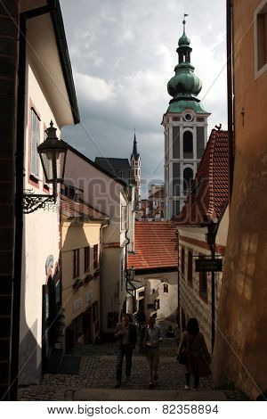 CESKY KRUMLOV, CZECH REPUBLIC - MAY 6, 2013: Narrow medieval street and St Jost Church in Cesky Krumlov, South Bohemia, Czech Republic.