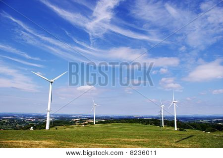 Wind energy farm and clear blue sky.