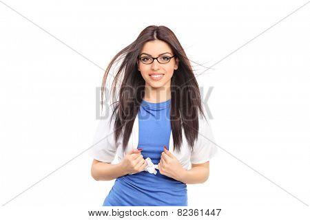 Female superhero tearing her shirt isolated on white background