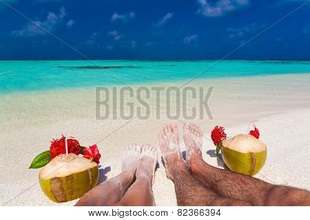Maldives, Women And Man Legs With Coconuts