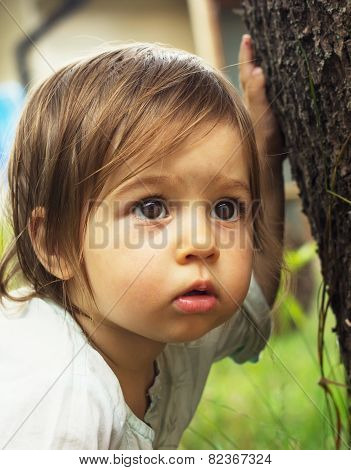 Cute Kid Thinking Outdoors