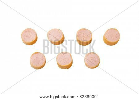 slices of raw wiener sausage isolated on white background