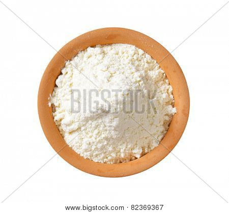 overhead view of finely ground flour in terracotta bowl