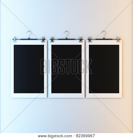 3d render illustration blank template layout of empty paper frame on hanger clips. Paint surface empty to place your photo, image, picture, text or logo.