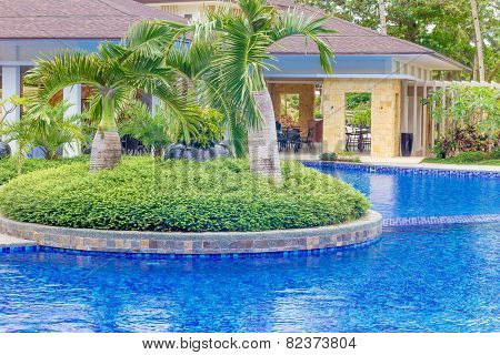 beautiful water pool in tropical hotel, summer vacation image