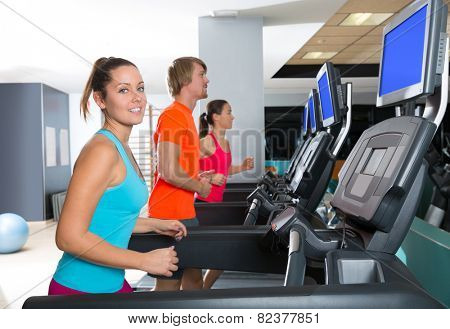 Gym treadmill group running indoor women and blond man