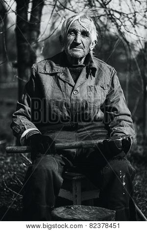 Black And White Grandfather In Workwear Outdoors With Axe