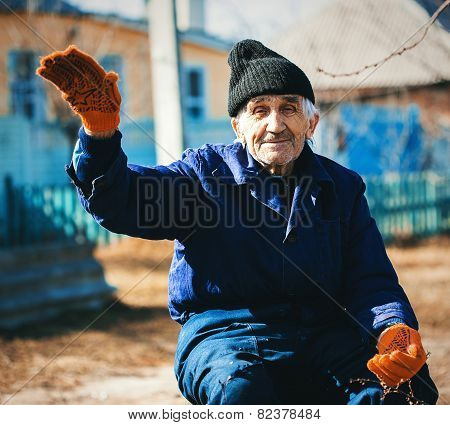 Cheerful Grandfather In Workwear Outdoors