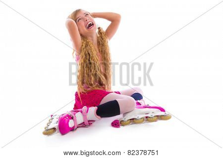blond pigtails roller skate girl sitting laughing happy on white background