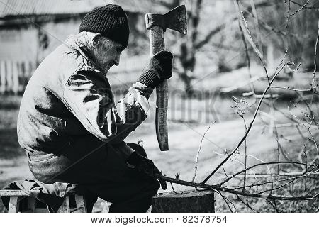 Monochrome Grandfather Working With Axe In Workwear