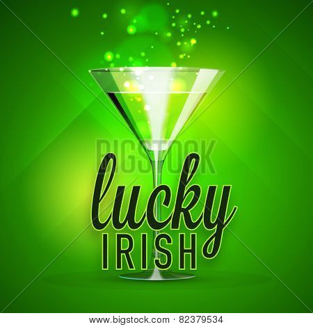 Happy St. Patrick's Day celebration with beer glass on shiny green background.