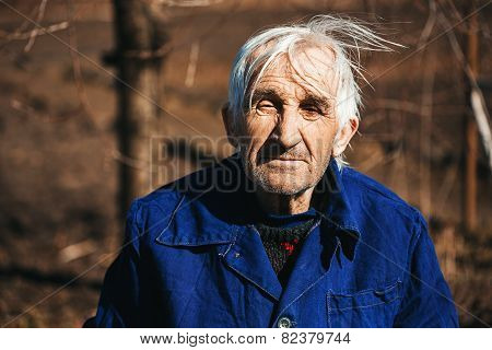 Portrait Of Grandfather In Blue Workwear