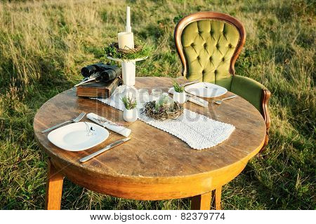 Table decor for romantic evening or photo session in the nature