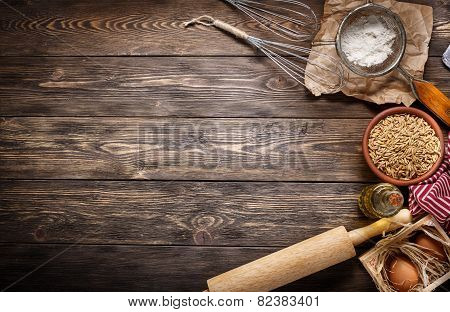 Ingredients For Baking On Empty Dark Wooden Background With Place  Your Text Or Recipes. Top View.