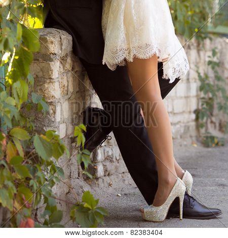 Legs newlyweds in wedding day