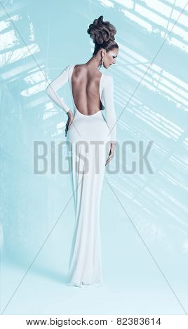 Sexy Woman In White Dress In Light Hothouse