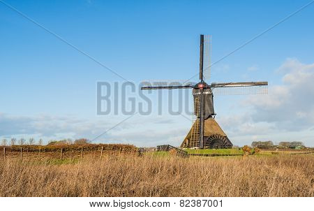 Dutch Polder Mill Against A Blue Sky