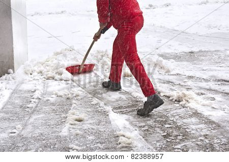 Worker Removes Snow