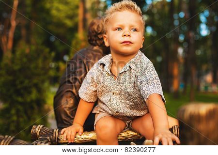 Thoughtful Blond Boy In Park