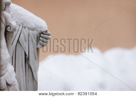 The Sculpture In The Snow On A Background Of Beige Wall