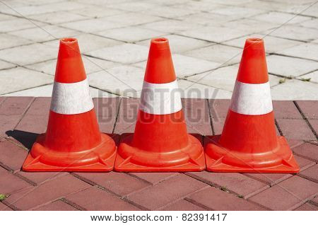 Three Signaling traffic cones