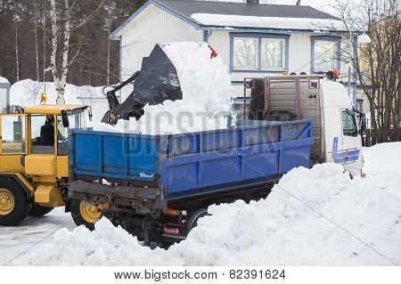 Wheel loader unloading snow