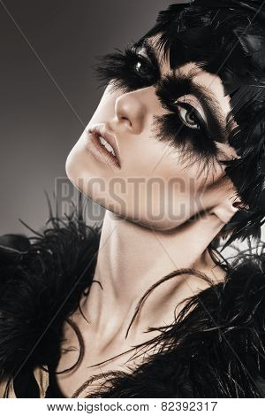 Sensual Woman With Black Feathers On Head