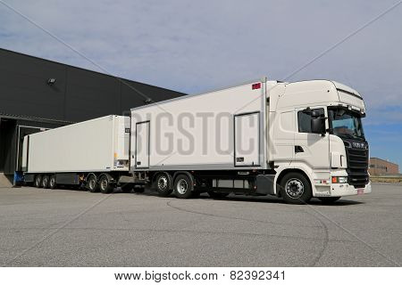 White Scania R560 Full Trailer Truck Unloading At A Warehouse