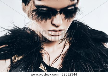 Sensual Woman With Black Feathers On Shoulders