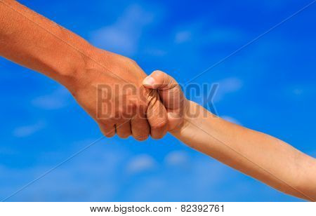 mother and son holding hands on sky