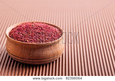 Spice Sumac In A Wooden Bowl