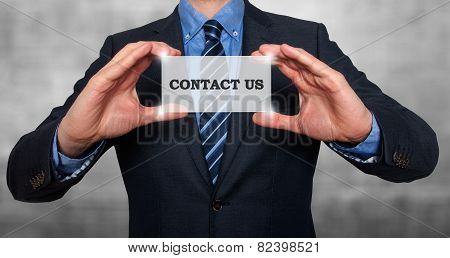 Businessman Holding Sign Contact Us