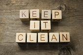 stock photo of dust-bin  - keep it clean on a wooden background - JPG