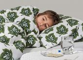 image of sick  - Portrait of sick little boy  in  bed - JPG