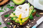 foto of avocado  - Avocado sandwich with arugula - JPG
