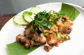 picture of gai  - Traditional Thai crispy pork dish with green garnish - JPG