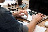 pic of concentration man  - Closeup of man hands working on laptop in office  - JPG