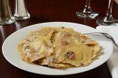 picture of truffle  - A plate of gourmet mushroom ravioli in a truffle sauce - JPG