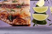 image of pangasius  - Dish of Pangasius fillet with rosemary and lime on metal tray and color wooden table background - JPG