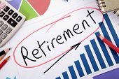 image of retirement  - The word Retirement written on a bar graph surrounded by pencils books and calculator - JPG