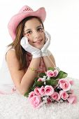 image of cowgirl  - Closeup of a beautiful teen girl in formal gloves and a pink cowgirl hat - JPG