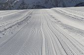 Постер, плакат: Fresh Snow Groomer Tracks On A Ski Piste