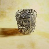 foto of prism  - metal frame hexagonal prism in an abstract design - JPG