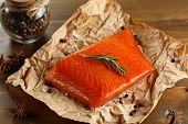 foto of salmon steak  - Salmon steak with herbs on old paper - JPG