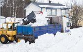 image of wheel loader  - Wheel loader unloading snow on a truck - JPG