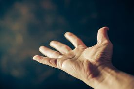 stock photo of hand god  - hands begging on a brown background - JPG