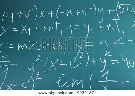 Maths formulas on chalkboard background