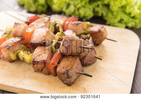 Close Up Barbecue On Wooden Chopping Board At The Table