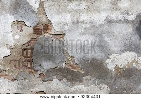 Damaged Plaster Of A Brick Wall